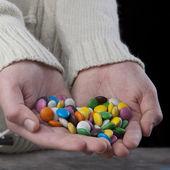 Hands full of sweets — Foto de Stock