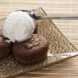 Chocolate souffle and vanilla ice cream on table, — Stock Photo