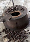 Old coffee roaster on wooden table — Stock Photo