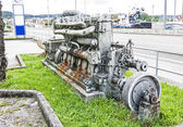 Old boat engine near the road. — Stock Photo