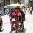 Bicycle taxi on street of Havana — стоковое фото #41994851