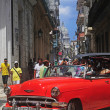 Red old American car on the raw street in Old Havana — Stock Photo #41995211