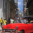Red old Americcar on raw street in Old Havana — стоковое фото #41995211
