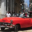 Red old Americcar on raw street in Old Havana — Foto Stock #41995213