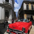 Red old American car on the raw street in Old Havana — Stock Photo #41995217