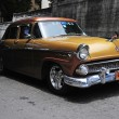 Постер, плакат: Beautiful renovated classic old American car