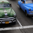 Постер, плакат: Classic old American cars at the intersection