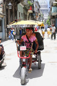 Bicycle taxi on street of Havana — Stock Photo