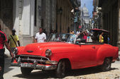 Red old American car on the raw street in Old Havana — Stock Photo