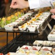 Stock Photo: Catering stuff arranging finger food