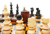 Chess figures with sand-glass and smoking pipe — Stock Photo