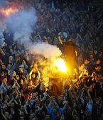 Soccer or football fans using pyrotechnics — Stock Photo