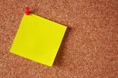 Yellow sticky note on a board — Stockfoto