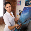 Professional female painter at work — Stock Photo