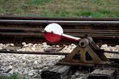 Rail and the train stops at the next — Stock Photo