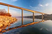 Steel bridge across river — Stock Photo