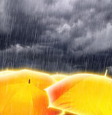 Umbrellas in Rainy Storm Clouds — Stock Photo