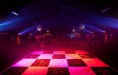 Glowing Chequered Dancefloor — Stock Photo