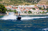 Man riding a jet ski on the sea — Foto de Stock