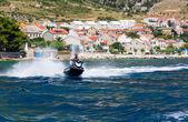 Man riding a jet ski on the sea — Stockfoto