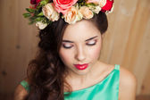 Beauty portrait of woman with flower wreath and bouquet on wood background. Bride. — Stok fotoğraf