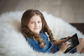 Cute little girl with tablet pc — Foto de Stock