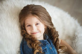 Cute little girl with braids — Stock Photo