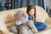 Cute little girl with teddy bear — Stock Photo