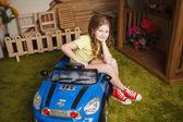 Little girl with tiy car — Stock Photo