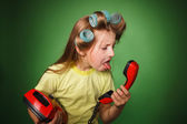 Crazy little girl hosewife screaming into the phone — Stock Photo