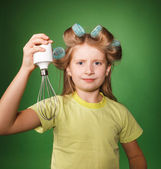 Little girl housewife holding kitchenware — Stock Photo