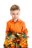 Happy young boy with a present box smiles isolated  — Stock Photo