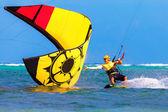 Young smiing  kitesurfer on sea background Extreme Sport Kitesur — Stock Photo