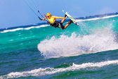Jumping kitesurfer on sea background Extreme Sport Kitesurfing — Foto Stock
