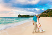 Wedding. Bbride and groom kissing on the tropical coast at sunse — Stok fotoğraf