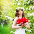 Portrait of a beautiful young woman in a wreath of spring flower — Stock Photo