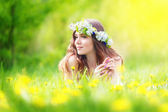 Image of pretty woman lying down on dandelions field, happy  che — Stock Photo