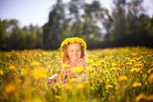 Image of happy child on dandelions field, cheerful little girl r — Stock Photo