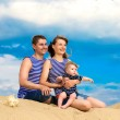 Happy family, mom, dad and little son in striped vests having fu — Stock Photo #47728631