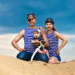 Happy family, mom, dad and little son in striped vests having fu — Stock Photo #48167961