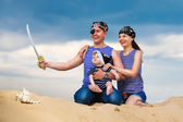 Happy family, mom, dad and little son in striped vests having fu — Stock Photo