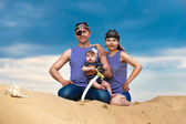 Happy family, mom, dad and little son in striped vests having fu — Foto Stock
