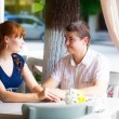 Outdoor portrait of young sensual couple in summer cafe. Love an — Stock Photo #48549035
