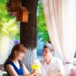 Outdoor portrait of young sensual couple in summer cafe. Love an — Stock Photo #48549041