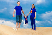 Happy family, mom, dad and little son in costume Superman having — Stock Photo