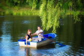 Loving couple in the boat. Summer vacation concept. — Foto Stock