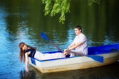 Loving couple in the boat. Summer vacation concept. — Stock Photo