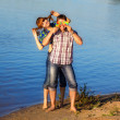 Happy and young couple having fun on the beach. Summer vacation. — Stock Photo #48879191