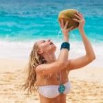 Young beautiful woman with long hair in white bikini, drinking c — Stock Photo