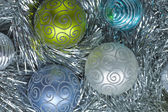 Christmas decorations. New Year ball in tinsel and spangles. — Стоковое фото